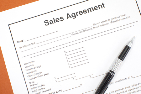 Close - up Business document paper of Sales agreement Stock Photo