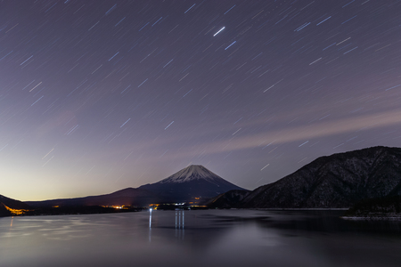 prefecture: Lake Motosu and mt.Fuji at night time in winter season. Lake Motosu is the westernmost of the Fuji Five Lakes and located in southern Yamanashi Prefecture near Mount Fuji, Japan Stock Photo