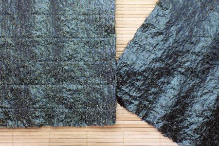Nori , Japanese edible seaweed . Used chiefly as an ingredient wrap of sushi