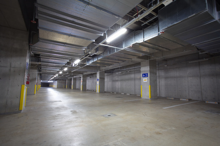 Parking garage underground interior, neon lights at night