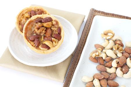 Mixed nuts and a baked dish tart