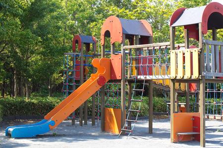Children playground at pubic park in summer season Stock Photo