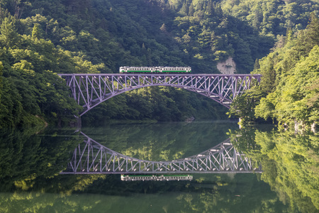 Tadami railway line and Tadami River in summer season at Fukushima prefecture.