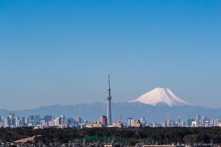 Tokyo city view , Tokyo skytree and Mountain Fuji. Mount Fuji lies about 100 kilometres south-west of Tokyo, and can be seen from there on a clear day.