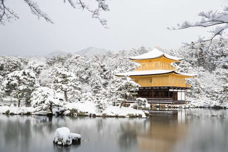 Zen temple Kinkakuji ( Golden Pavilion ) with snow fall in winter 2017. Kinkakuji is one of Kyoto's leading temples and Recognized by UNESCO as a World Cultural Heritage Editorial