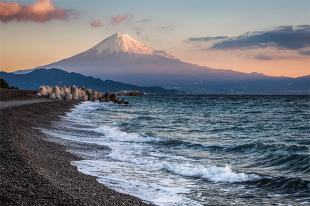 Mt. Fuji and sea beach in winter morning. Seen from Miho no Matsubara , a scenic area. The Miho Peninsula in Shimizu Ward of Shizuoka City, Japan.