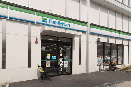 Osaka , Japan - Mar 19 , 2017  : FamilyMart (one word) convenience store is the third largest in 24 hour convenient shop market, after Seven Eleven and Lawson. Editorial