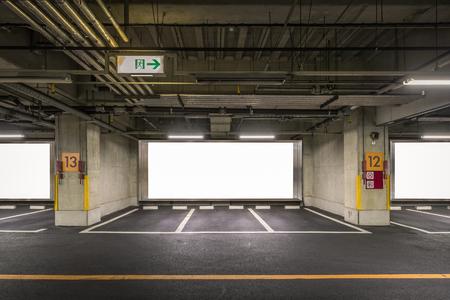 Parking garage underground interior with blank billboard 版權商用圖片