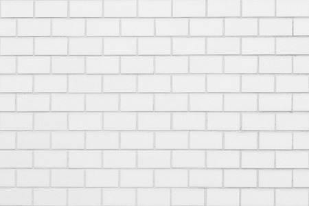 White brick wall seamless background and texture Imagens