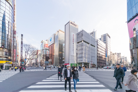 TOKYO, JAPAN - March 01 , 2017 : Cityscape in the Ginza District. The district offers high end retail shopping. Éditoriale