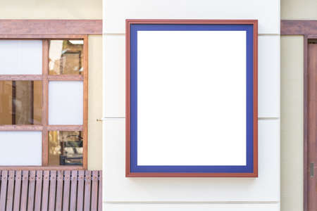 Blank billboard in front of store Stock Photo