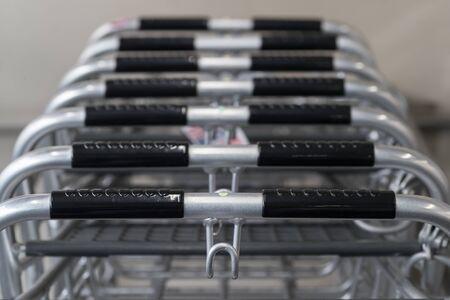 Closed-up shopping cart at supermarket