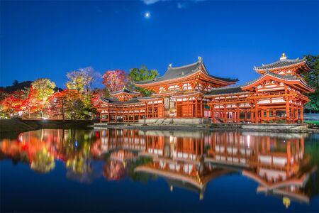 Kyoto Byodo-in Templw in autumn season with light up