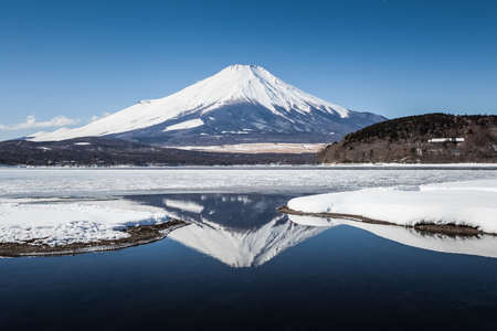 Mountain Fuji with reflection and Yamanakako ice lake in winter  Stock Photo