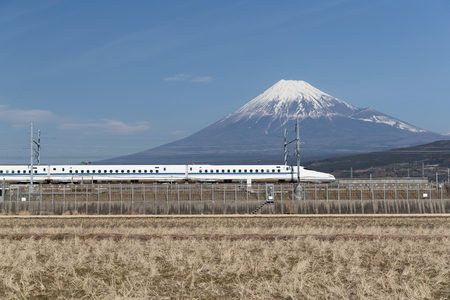 Tokaido Shinkansen with Mountain Fuji in behind. The Shinkansen , a network of high-speed railway lines in Japan