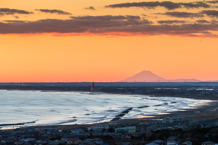 Mt. Fuji and the beach at Iioka town , Chiba prefecture. Mt.Fuji is 185km. away but can be seen on clear days. Stock Photo
