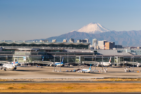 TOKYO, Japan - Dec 14, 2017: Haneda Airportand Mount Fuji ina clear day. Haneda or Tokyo International Airport is one of the two primary airports that serve the Greater Tokyo Area. Editorial