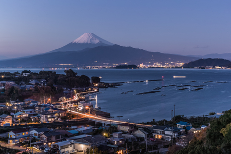 View of Izu town with Mountain Fuji and Suruga bay in winter evening. Reklamní fotografie