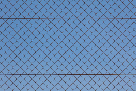 Metal fence and blue sky background