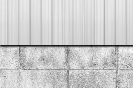 Metal fence and concrete block wall background
