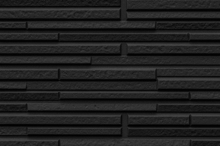 Black modern stone tile wall pattern and background