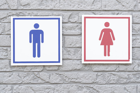 Bathroom sign on stone wall Stock Photo