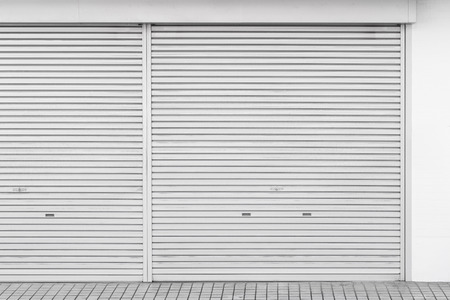 Closed white metal shutter door Banque d'images - 119243461