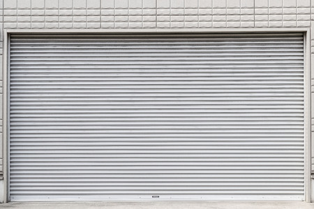 Steel roll doors in front of the store closed 스톡 콘텐츠