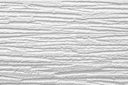 White painted plastic building wall texture and background 免版税图像