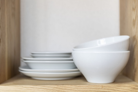 Cup and dish placed on the kitchen cabinet