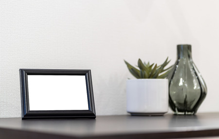 Empty picture frame placed on the desk in the bedroom