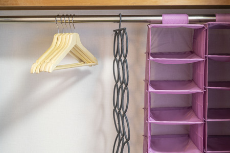 Hangers and plastic clothes storage shelves in the bedroom