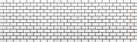 Panorama of White brick tile wall seamless background and texture