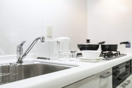 Sink at the small kitchen cabinet in the apartment room