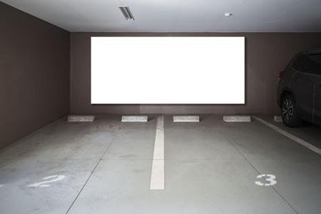 Parking garage underground interior with blank billboard 스톡 콘텐츠