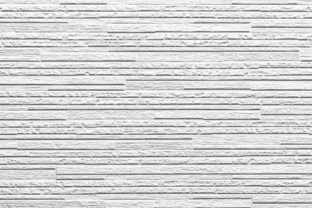 The modern white concrete tile wall background and texture