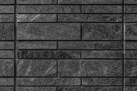 Detail of real black slate wall texture and background 스톡 콘텐츠