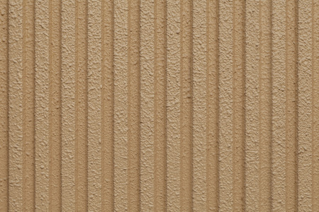 Yellow-brown cement wall texture and seamless background