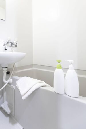 Bottles of shampoo and bath soap placed in the bathtub in the white bath 写真素材