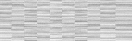 Panorama of white modern stone wall pattern and background 写真素材