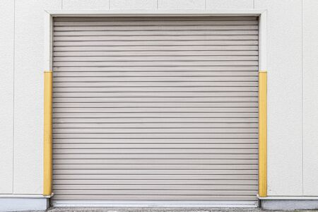 White Automatic shutters door in a house