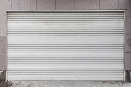 White Automatic shutters door in a house Archivio Fotografico