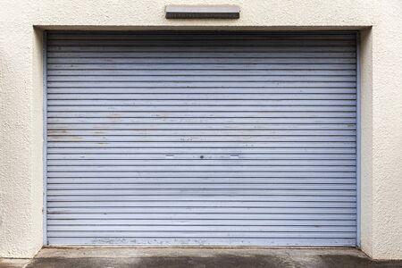 Illuminated grunge metallic roller white shutter door Imagens