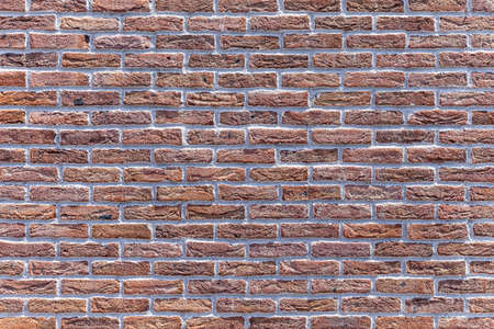 Vintage old brown brick wall texture and seamless background 免版税图像