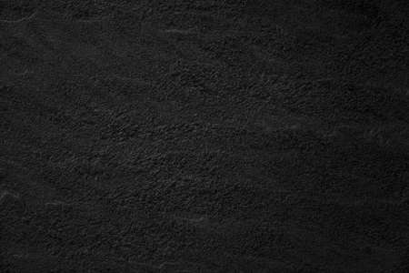 Black concrete stone texture for background in black. Cement and sand grey dark detail covering.