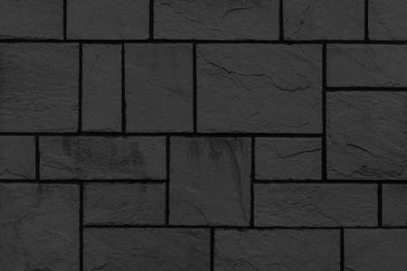 Block pattern of black stone cladding wall tile texture and seamless background Stockfoto
