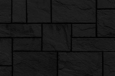 Block pattern of black stone cladding wall tile texture and seamless background Stock fotó
