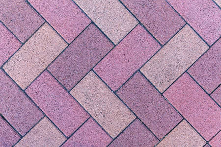 Vintage purple cobblestone pavement pattern and background