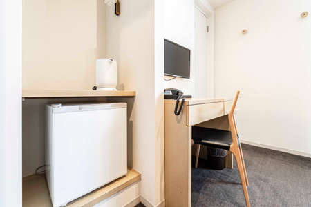 Small refrigerators and work area in a Japanese hotel room