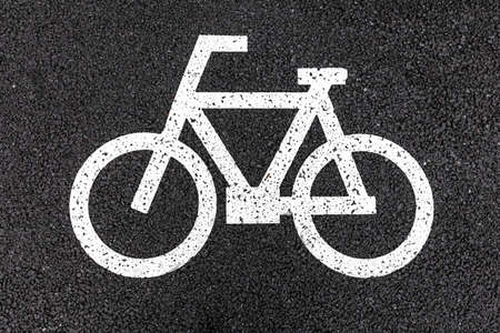 Close - up White bicycle parking sign on asphalt